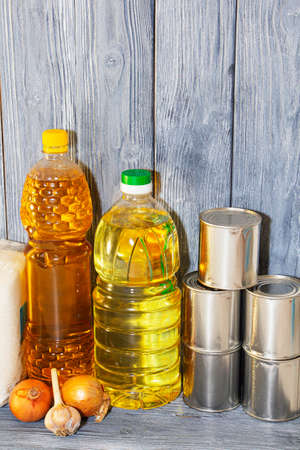 canned food and vegetable oil on a wooden shelf, food crisis