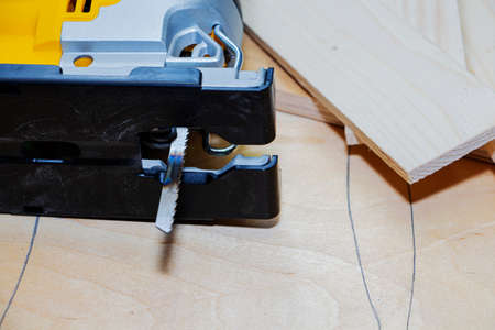 power tools, working with an electric jigsaw and wood Imagens
