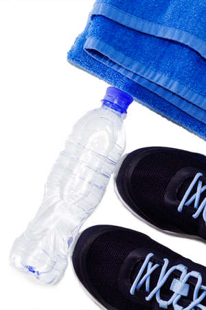 Yoga Mat, sports shoes, water bottle concept of healthy living, healthy eating, sports and diet
