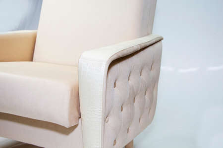 Vintage furniture: reclining chair made of fabric, on a light background