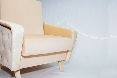 Vintage furniture: reclining chair made of fabric, on a light background.