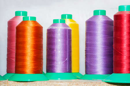 Colorful reels with threads, backgrounds, images related to the tailor