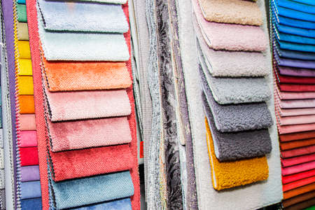 A set of fabric samples for furniture finishing. Multicolored upholstery stripes