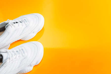 sports shoes on a bright colored background. Healthy lifestyle, yoga, the concept of sport.