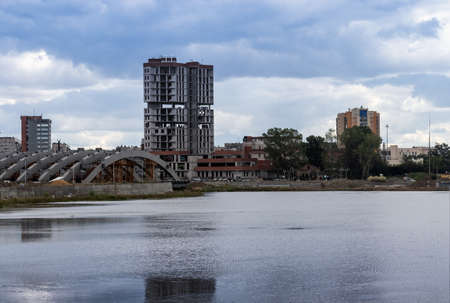 A high-rise building under construction on the banks of the Miass River in Chelyabinsk, Russia.