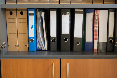 office cabinet: Different folders on the shelf office cabinet Stock Photo