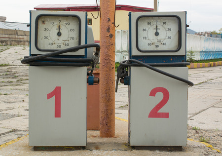 abandoned gas station: Two gasoline pumps with rounded dial on the abandoned gas station Stock Photo