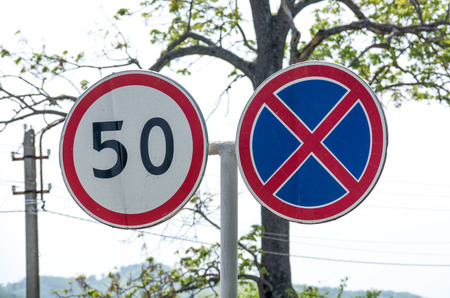 limitation: Two paired road sign. Speed limitation.