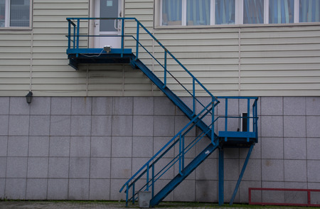 second floor: Blue metal stairway to second floor of building Stock Photo