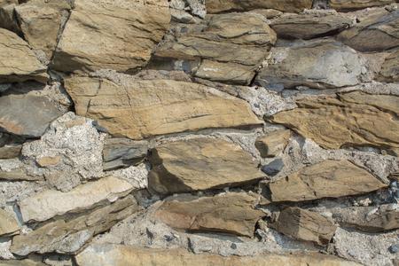 irregular shapes: Stone Brick Wall made of fragment stones in irregular shapes Stock Photo