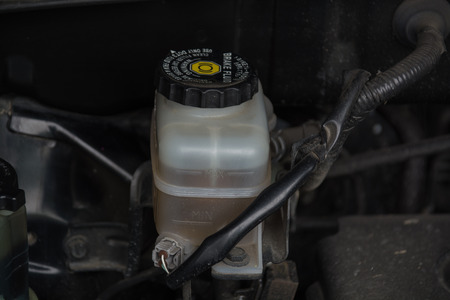 fluid: Close up look at the brake fluid reservoir Stock Photo