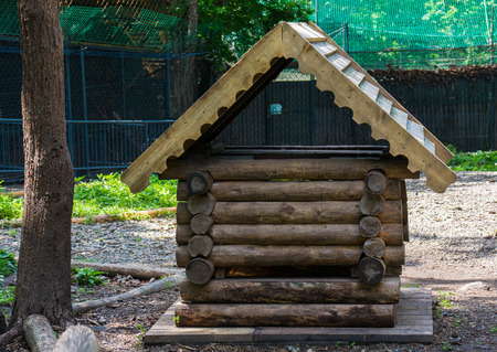 aviary: Small wooden house for animals in the aviary reserve