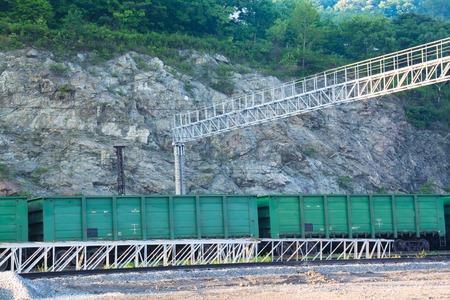flatcar: Freight cars on a rail near steep slope. Summer day Stock Photo