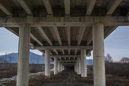 Bottom view on the bridge. Big concrete overpass.