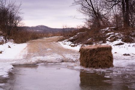 frozen creek: Haystack in the frozen creek . Winter morning