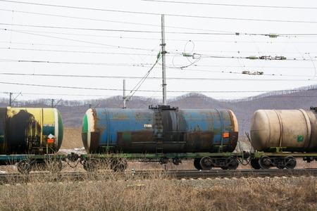 Railway Cisterns Under Electric Wires. Autumn Landscape. Stock Photo