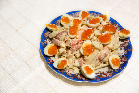fishery products: Dish with seafood salad. Salmon roe and eggs. The food table.