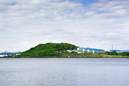Small island with few buildings. Stock Photo