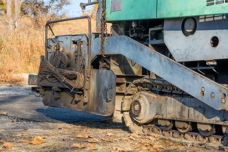 Asphalt paver machine. Part of road building equipment. Stock Photo