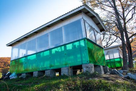 Long pavilion based on cement blocks. White-green gazebo. Reklamní fotografie