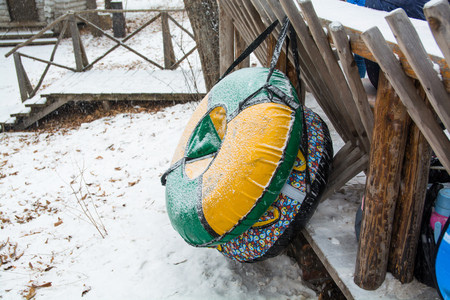 Group of Snow Tubing at tubing park. Vibrant Tubings Hanging On the Railing.