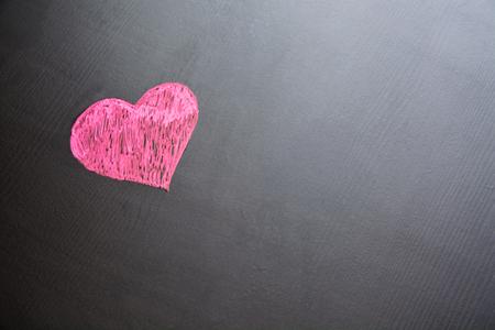 Drawing of heart on black. Minimalistic image.