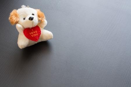Soft plush toy dog with heart. Symbol of valentines day. Reklamní fotografie