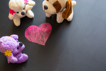 Soft plush toys around sketch of heart. Symbol of valentines day.