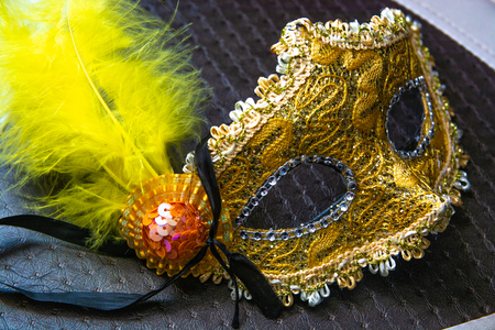 Yellow masquerade mask. Ornate carnivale mask with feather.