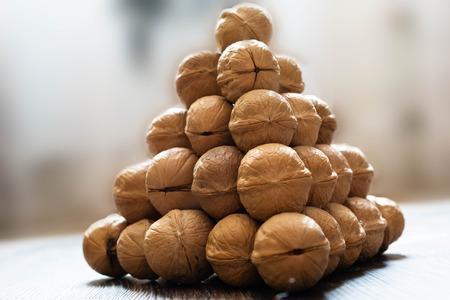 Pyramid of walnuts. Closeup view from side. Macrophotography.