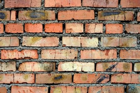 corroded: corroded common brick wall Stock Photo