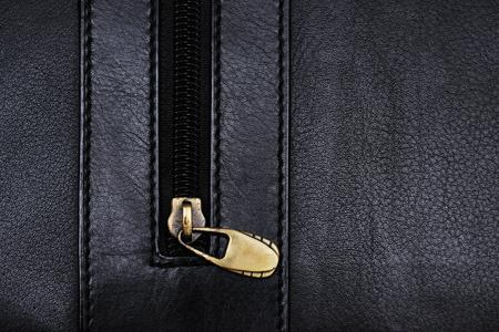 rawhide: Black leather folder fragment with zipper Stock Photo