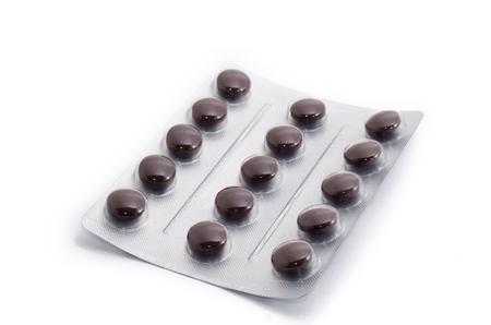 blister: Brown pills in aluminium blister isolated
