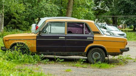 old classic retro car with multicolored doors