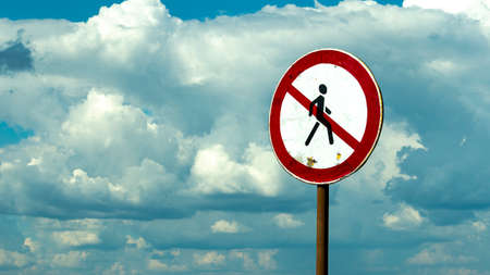 road sign passage is forbidden against the blue sky