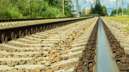 electric train tracks on a bright Sunny day