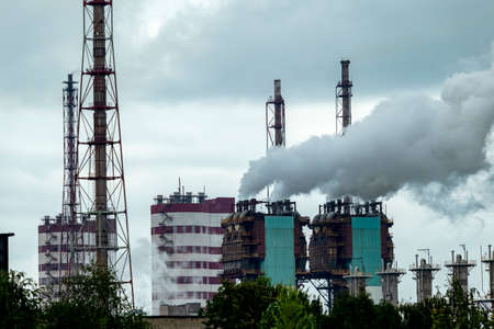 huge Smoking pipes of a petrochemical plant