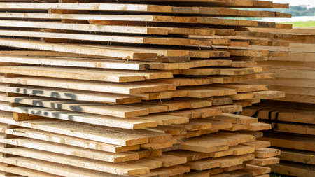 Wooden planks are laid with the end part stacked on top of each other