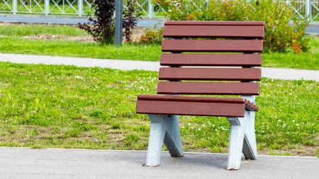 brown wooden bench in a public Park Foto de archivo