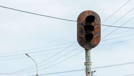 rusty and abandoned semaphore on the railway tracks