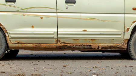 old and rotten thresholds of a yellow rarity car