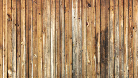 a wall of old worn-out vertical boards, backgrounds, textures