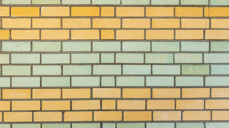 horizontal wall of yellow and green bricks, backgrounds, textures