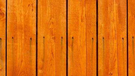 vertical orange wooden boards with nails, backgrounds, textures Foto de archivo