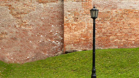 lamppost on the background of an old brick wall, backgrounds, textures
