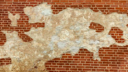 red brick wall with elements of collapse, backgrounds, textures Foto de archivo