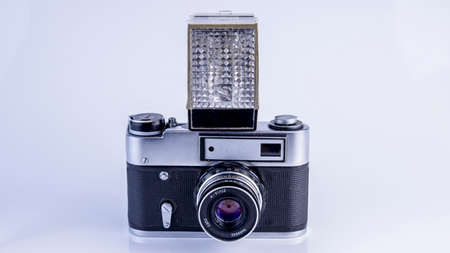 old soviet camera with flash on white background