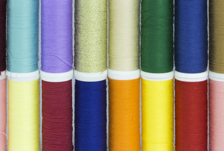 combination: The combination of colorful spool arranged in two rows