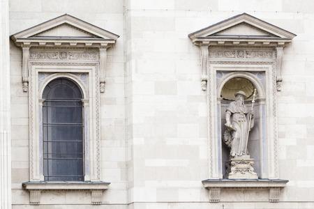 distinguishing: Old traditional window of clasical white stone house