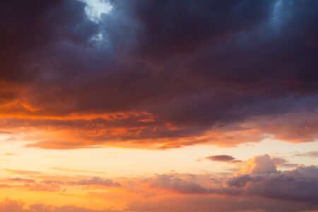Storm clouds at sunset in bright colors
